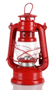 Red kerosene lamp isolated on white
